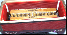 The four reed sets in an accordion with four bass voices.